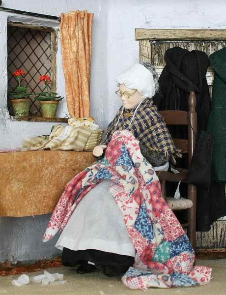 Old_Lady_Sewing_4c32fa0bbc5a9